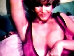 Betty Walts' Big Tits Bounce During Retro Sex