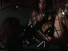Caged Girl Humiliated By Dominatrix