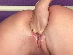 Lewd blonde fists her pussy after rubbing her clit