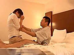 Slim Japanese masseuse gives handjob and blowjob to her client
