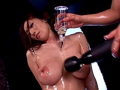 Oiled up Julia gets her pussy toyed deep and hard