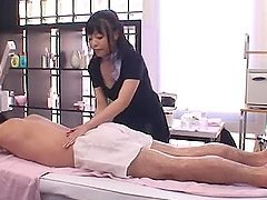 Sexy Japanese masseuse gives a titty fucking to her client