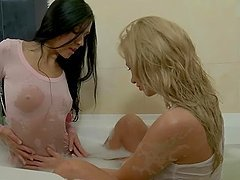 Elizabeth and Lindsey play with each other's vaginas in the bathtub