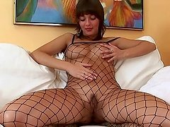 Naughty Lillike masturbates in sexy fishnet dress