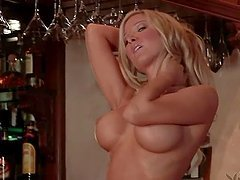 Blonde cutie Natalie Kane has a photosession in a bar