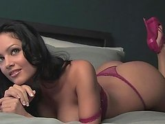 Sexy brunette Raquel Reese demonstrates her awesome big boobs