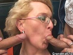 Horny Guys Have an Outdoor Threesome With a Mature Blonde Slut