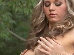 Pretty Megan Alexis shakes her hot tits in the backyard