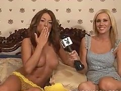 Hot Tara Vaughn lies on a bed and gives an interview