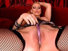 Sandy the horny babe in lingerie and fishnets in close up video