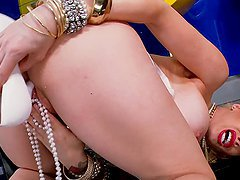 Busty blonde Candy Manson plays with her snatch in the kitchen