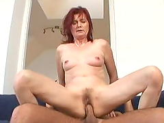 Redhead mature woman gets pounded hard on a sofa