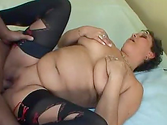 Slutty middle aged woman gets pounded on a bed
