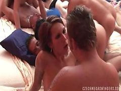 Cock-Hungry Sluts Share Everything In This Massive Swingers Orgy