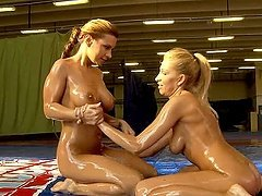 Clara G. and Dorothy Black fondle each other's oiled bodies