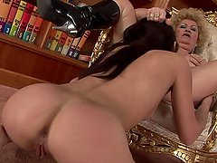 Pretty brunette girl gets fucked with strap on by blonde mature babe