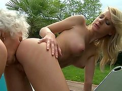 Slim blonde girl gets fucked with strap on by old lady