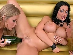 Three hot lesbians slam each other's pussies with a bottle