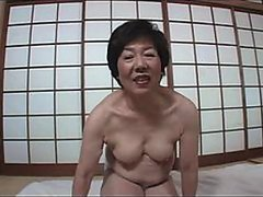 Japanese Granny Strips and Lets Guy Tease Her With a Tiny Vibrator