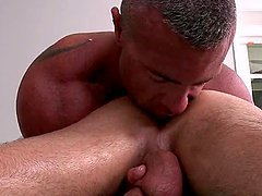 Gay masseur pleasing his client with a rimjob