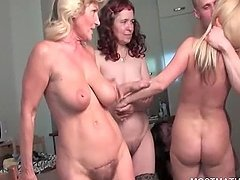 Orgy with blonde mature fucked over the couch