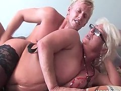 Mature blonde gets pussy filled with large shaft