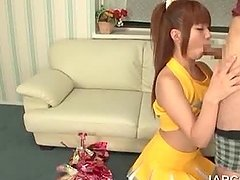 Asian sexy cheerleader on knees giving blowjob