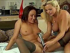 Blonde and brunette toy their hot pussies and lick them