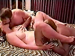 Mature slut enjoys threesome interracial banging in homemade clip