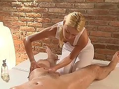 Blonde masseuse blows big dick and gets pounded