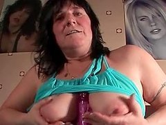 Mature brunette rubbing her twat and big boobs