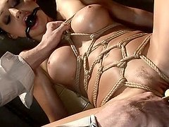 Aletta Ocean the hot brunette with fake tits in hot BDSM video