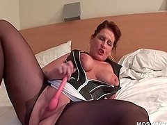 Mature tramp in pantyhose pleasing cunt with sex toy