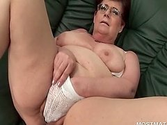 Mature babe in glasses working her tits and pussy