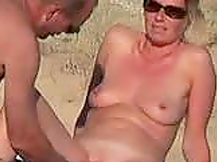 French hottie gets her pussy touched by her hubby on a nude beach
