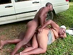 Fat ebony granny gets fucked by a young stud outdoor