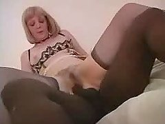 Mature blonde gives a blowjob to a black stud and rides his prick