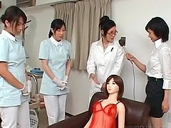 Asian nurse giving handjob slurps jizz out of cock