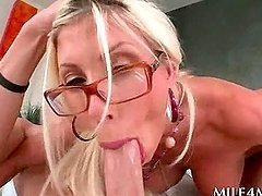 Ash blonde MILF in glasses mouth fucking a massive shaft in POV
