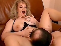 Curly mature bitch in stockings gets her pussy fucked