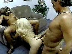 Two slutty chicks have an amazing FFM sex in a living room