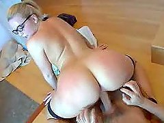 Blonde girl in glasses and stockings rides a dick and sucks it