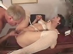 Mature brunette gets her ass slammed hard in a study