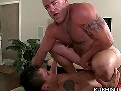 Gay dirty masseur filling his butt hole with straight cock
