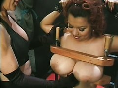 Dominatrix Tortures Natural Breasts