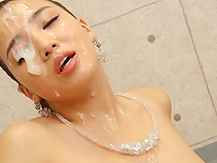 Pretty Japanese lady shows her hot body and gets facialed