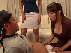 Four Japanese bitches play with some guy's cock indoors