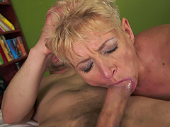 Blonde granny gives passionate blowjob to younger guy
