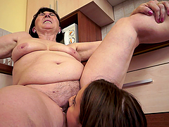 Flexible brunette girl has lesbian sex with BBW in a kitchen