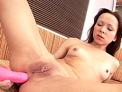 Irene fingers her holes before smashing them with a dildo